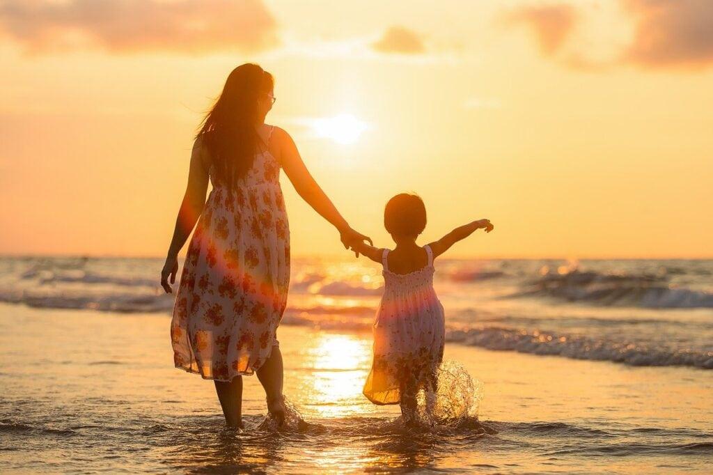 mother-child-beach-sunset