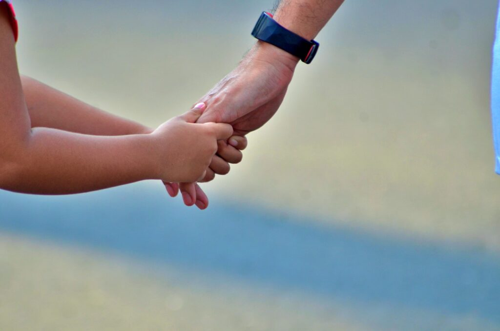 child-holding-hands-parent